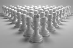 groupe de vue de yeux d'oiseau du rendu 3D de forme de flèche d'échecs de gage avec le chef devant eux en papier peint blanc de f Photos stock