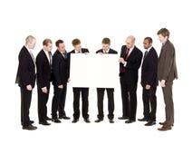 Groupe des hommes avec un signe propre Photos libres de droits