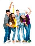 Groupe des jeunes avec des pouces vers le haut Photos stock