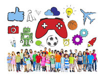 Groupe divers d'enfants avec des passe-temps Photos stock