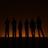 Groupe et contre-jour orange. Images stock