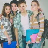 Groupe heureux d'étudiants tenant des carnets, d'isolement sur le fond blanc Images stock