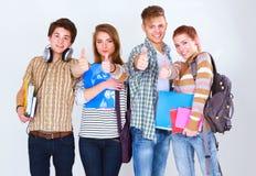 Groupe heureux d'étudiants tenant des carnets, d'isolement sur le fond blanc Photographie stock