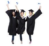 Groupe heureux de filles de graduation Photographie stock libre de droits