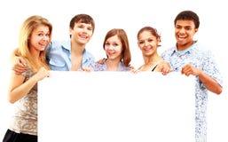 Groupe heureux de se retenir occasionnel d'amis Image libre de droits