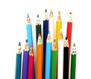 Groupe heureux de visages de crayon Photographie stock