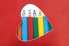 Groupe heureux de visages de crayon Photos stock