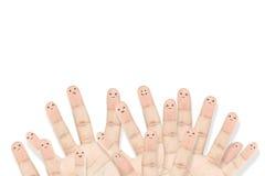 Groupe heureux de visages de doigt en tant que réseau social Photos libres de droits