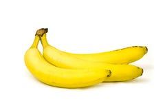 Groupe jaune mûr de banane d'isolement sur le blanc Image stock