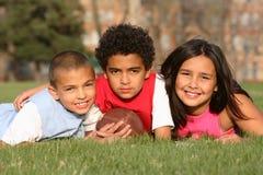 Groupe multiracial de gosses Photos stock