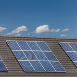 Grouped solar panels on a roof Royalty Free Stock Photos