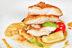 Grouper fillet. With zucchini and mustard sauce stock photography