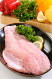 Grouper fish fillet. Several pieces of sea bass on a cutting board Royalty Free Stock Image
