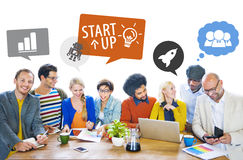 Groupg of Multiethnic Designers in a Meeting with Speech Bubbles Royalty Free Stock Photos