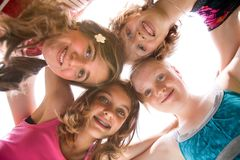 Grouphug in the sun Stock Photo