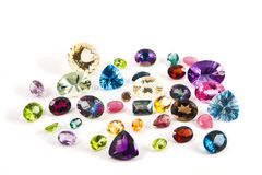 A grouping of faceted gemstones Stock Photo