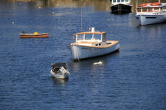 Grouping of fishing boats in waters of seaside town, Perkins Cove, Maine, 2016 Royalty Free Stock Image