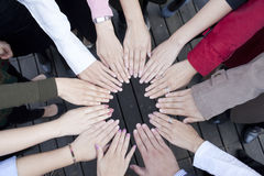 Grouping hands to show unity Stock Photo