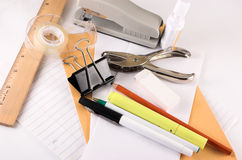 Grouping of office supplies. Many different office supplies all grouped together, isolated on a white background Stock Photos