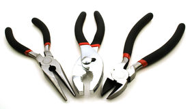 Grouping of pliers. Group shot of adjustable and needle-nose pliers with a pair of wire cutters Stock Photos