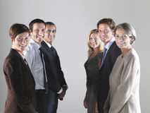 Groups Of Businesspeople In Two Rows Stock Photo