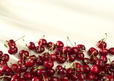 Groups of cherries on a white background in sunny light Royalty Free Stock Photos