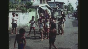 Groups Of Children Posing. PHILIPPINES, CITY OF LAS PINAS, APRIL 1978. Two Shot Sequence Of Groups Of Children Posing, Smiling And Fighting For A Good Position stock footage