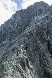 Groups of clients led by mountain guides on ridge in the mountains. royalty free stock photo
