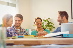 Groups of colleague looking at the smartphone Royalty Free Stock Image