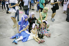 Groups of costumed players. Guangzhou city China: Participants dress in Cosplay costumes during the  Ani-Com & Games  at the Guangzhou Convention & Exhibition Royalty Free Stock Image