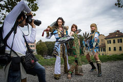 Groups of costumed players are photographed Royalty Free Stock Image