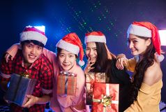 Groups of friends are Asian enjoying the party. Groups of friends are Asian men and women decorated the Christmas tree. To celebrate the Christmas season. They royalty free stock photos