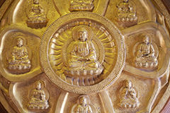 Groups of golden Buddha statue, stucco on chinese temple wall in Dragon Temple Stock Image