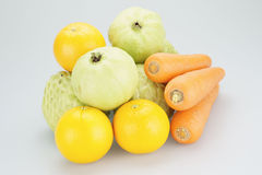 Groups of guava custard apple oranges and carrots Royalty Free Stock Photo