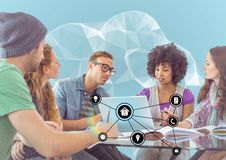 Groups of people discussing over laptop with multiple models interface Royalty Free Stock Images