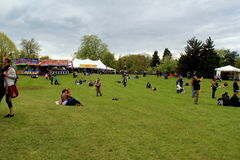 Groups of people gathered together listening to music at the annual Lilac Festival, Rochester, New York, 2016. Peaceful scene with the groups of people gathered stock photo