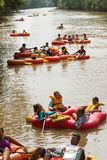 Groups Of People Go Tubing Down Chattahoochee River In Georgia. Duluth, GA / USA - July 14, 2018:  Groups of people float down the Chattahoochee River on rafts royalty free stock images