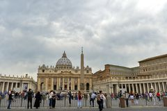 Groups of people waiting in Saint Peter`s Square to visit Sixtine Chapel Stock Photos