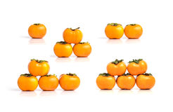 Groups of ripe persimmon isolated on white background Stock Images