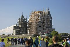 Groups of tourists go to see the masterpiece of Russian wooden architecture - Kizhi.