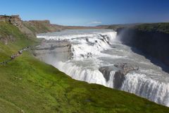 Groups of tourists visiting Gullfoss (Golden falls) waterfall, I Stock Photo