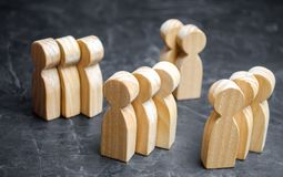 Groups of wooden people. The concept of market segmentation. Mar royalty free stock photography