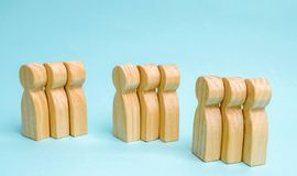 Groups of wooden people. The concept of market segmentation. Mar. Keting segmentation, target audience, customer care. Market group of buyers. Customer analysis stock photos