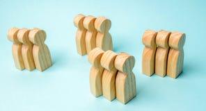 Groups of wooden people. The concept of market segmentation. Marketing segmentation, target audience, customer care. Market group. Of buyers. Customer analysis stock photo