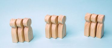 Groups of wooden people. The concept of market segmentation. Mar royalty free stock photo