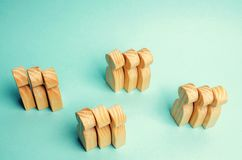 Groups of wooden people. The concept of market segmentation. Mar. Keting segmentation, target audience, customer care. Market group of buyers. Customer analysis royalty free stock photography