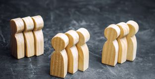 Groups of wooden people. The concept of market segmentation. Mar stock photos