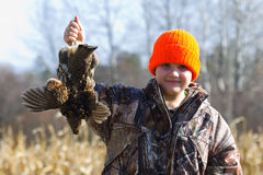 Grouse Hunter. A grouse hunter with a Ruffed Grouse Stock Photos