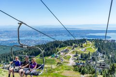 Grouse Mountain chair lift in Vancouver stock photo