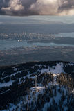 Grouse Mountain Wind Turbine with Vancouver Downtown Royalty Free Stock Photo